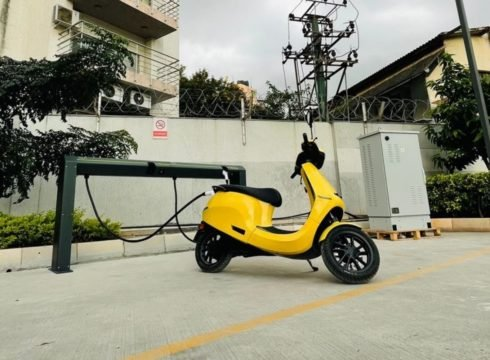 An Ola Electric scooter being charged at the first functional hypercharger in Bengaluru